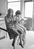 Daydreaming at the Education Centre, Wester Hailes, Scotland, 1979.  John Walmsley was Photographer in Residence at the Education Centre for three weeks in 1979.  The Education Centre was, at the time, Scotland's largest purpose built community High School open all day every day for all ages from primary to adults.  The town of Wester Hailes, a few miles to the south west of Edinburgh, was built in the early 1970s mostly of blocks of flats and high rises.