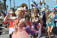 Mardi Gras revelers parade down the Venice Boardwalk on Saturday, February 18, 2012.