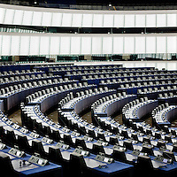 The (empty) main session hall at the European Parliament prior to the arrival of thousands of the parliament's employees who regularly travel between the three sites of government in Brussels, Strasbourg and Luxembourg.