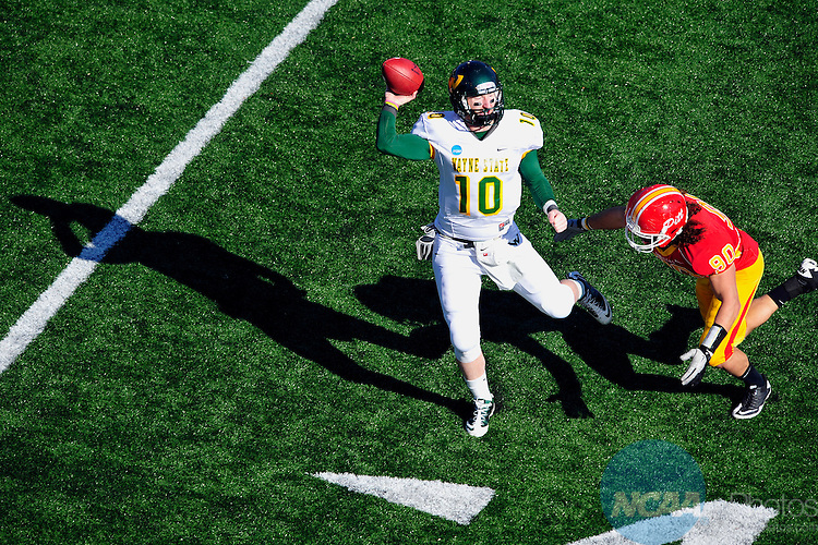 17 DEC 2011: Quarterback Mickey Mohner (10)  of Wayne State University rolls out under pressure from Joe Uzzel (90) of Pittsburg State during the Division II Men's Football Championship held at Braly Municipal Stadium in Florence, AL.  Pittsburg State defeated Wayne State University 35-21 for the national title.  Grant Halverson/ NCAA Photos