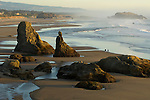Couple strolling at Bandon Beach, OR
