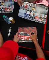 Jun 10, 2016; Englishtown, NJ, USA; NHRA funny car driver Cruz Pedregon signs autographs during qualifying for the Summernationals at Old Bridge Township Raceway Park. Mandatory Credit: Mark J. Rebilas-USA TODAY Sports