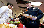 John Tani with the Murray Fire Department, right, grabs a roll at a holiday buffet luncheon put on by the Murray High School ProStart class at Fire Station 81 in Murray, Wednesday, Dec. 19, 2012. ProStart is a national program for students to learn culinary and management skills in anticipation of working the restaurant business or attending culinary school.