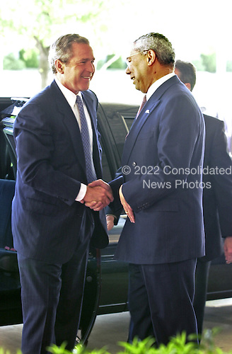 United States President George W. Bush is greeted on his arrival at the US State Department in Washington, DC by US Secretary of State Colin Powell on May 7, 2001.  Bush was visiting to speak to the Council of the Americas.  In his remarks, The President said he would ask Congress for Fast Track Trade authority this week.<br /> Credit: Ron Sachs / Pool via CNP