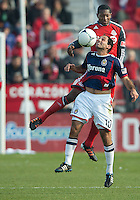 14 April 2012: Toronto FC defender Doneil Henry #4 and Chivas USA midfielder Nick LaBrocca #10 in action during a game between Chivas USA and Toronto FC at BMO Field in Toronto..Chivas USA won 1-0.