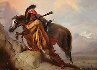 Detail of The Scalplock, painting, oil on canvas, by Alfred Jacob Miller, 1810-74, American artist, from the William Sr and Dorothy Harmsen Collection in the Denver Art Museum, Denver, Colorado, USA. This style of painting created a lasting impression of Native Americans, depicted wearing feather headdresses and ready to scalp their enemies. The figure is with his horse, holding a gun over his shoulder and the scalp in his right hand. Picture by Manuel Cohen