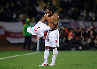 Glen Johnson of England swaps his shirt after a blood injury. USA tied England 1-1 in the 2010 FIFA World Cup at Royal Bafokeng Stadium in Rustenburg, South Africa on June 12, 2010.
