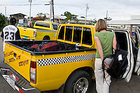 Yellow taxi truck at the airport picking up tourists, Bocas del Toro, Colon Island, Panama