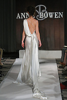 Model walks runway in an Astor wedding dress by Anne Bowen, for the Anne Bowen Bridal Spring 2012 runway show.