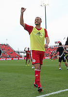 29 June 2013: Toronto FC forward Danny Koevermans #14 waves to the crowd after warm-ups during an MLS game between Real Salt Lake and Toronto FC at BMO Field in Toronto, Ontario Canada.<br /> Real Salt Lake won 1-0.