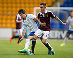 St Johnstone v Hearts...03.08.14  Steven Anderson Testimonial<br /> Dylan Easton is tackled by Liam Smith<br /> Picture by Graeme Hart.<br /> Copyright Perthshire Picture Agency<br /> Tel: 01738 623350  Mobile: 07990 594431