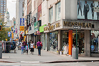 Stores and shopping in Downtown Brooklyn in New York on Sunday, September 29, 2013. The area has been for years a middle and lower economic shopping strip but because of increased development in the area, notably hi-rise luxury apartment buildings, chain stores and high-end retailers are moving in. Rents are rising and the smaller mom and pop stores, as well as regional chains are being forced out.  (© Richard B. Levine)