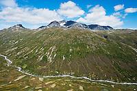 Surtningssue mountain peak rises above Memurudalen river valley, Jotunheimen national park, Norway