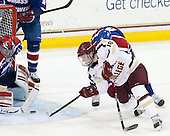 Connor Hellebuyck (UML - 37), Danny Linell (BC - 10) - The University of Massachusetts Lowell River Hawks defeated the Boston College Eagles 4-2 (EN) on Tuesday, February 26, 2013, at Kelley Rink in Conte Forum in Chestnut Hill, Massachusetts.