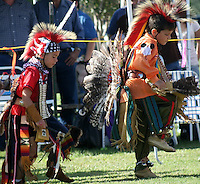 2 youths dancing in compition at the pow wow