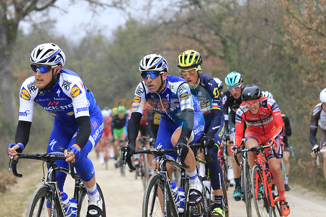 The peloton including Matteo Trentin (ITA) Quick-Step Floors on gravel sector 2 Bagnaia during the 2017 Strade Bianche running 175km from Siena to Siena, Tuscany, Italy 4th March 2017.<br /> Picture: Eoin Clarke | Newsfile<br /> <br /> <br /> All photos usage must carry mandatory copyright credit (&copy; Newsfile | Eoin Clarke)