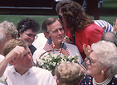 United States President George H.W. Bush listens to an unidentified woman during a Barbeque on the South Lawn of the White House in Washington, D.C. to commemorate the 20th anniversary of the Apollo 11 Moon landing on July 20, 1989.  Visible in the foreground of the photo are U.S. Vice President Dan Quayle, left, and first lady Barbara Bush, right.<br /> Credit: Ron Sachs / CNP