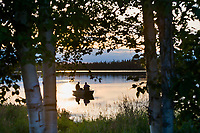 Boating on the Kashwitna lake, north of Willow, Alaska along the Parks Highway in southcentral Alaska.