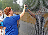 Washington, D.C. - June 29, 2005 --  Lois Diehl, who lost her husband, Michael, in the World Trade Center on September 11, 2001 visits the Vietnam Veteran's Memorial in Washington, D.C. on June 29, 2005.   Ms. Diehl is a member of the Coalition of 9/11 Families who arein Washington to lobby against the International Freedom Center (IFC).  Ms Diehl sports a tatoo on her back that says &quot;In loving Memory&quot; (of her Husband Michael).<br /> Credit: Ron Sachs / CNP