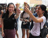 NEW YORK, NY - JULY 29:  Friends enjoy a free ice  cream cones  from the Museum of Ice Cream pop up shop in The Meatpacking District on opening day where patrons were offered free treats from 11am-3pm  in New York, New York on July 29, 2016.  Photo Credit: Rainmaker Photo/MediaPunch
