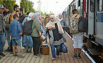 Refugees get off a train that has arrived in the Hungarian town of Hegyeshalom. Migrants and refugees aboard the train walk from here across the border into Austria. Hundreds of thousands of refugees and migrants flowed through Hungary in 2015, on their way to western Europe from Syria, Iraq and other countries.
