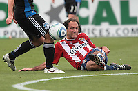 Nick LaBrocca (right) kicks the ball into the knee of Sam Cronin (left). Chivas USA defeated the San Jose Earthquakes 2-1 at Buck Shaw Stadium in Santa Clara, California on April 23rd, 2011.