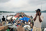 MALUKU, DEMOCRATIC REPUBLIC OF CONGO APRIL 26: Unidentified passengers wait to disembark from a boat after traveling for seven weeks on April 26, 2006 in the port in Maluku, outside Kinshasa, Congo, DRC. About five hundred passengers traveled on the boat from Kisangani to Kinshasa, a distance of 1750 kilometers. These passengers spent seven weeks on a crowded boat with only two toilets and had to sleep among cargo, and share space with live animals such as pigs, goats, crocodiles, birds, lizards, snakes etc, The Congo River is a lifeline for millions of people, who depend on it for transport and trade. During the Mobuto era, big boats run by the state company ONATRA dominated the traffic on the river. These boats had cabins and restaurants etc. All the boats are now private and are mainly barges that transport goods. The crews sell tickets to passengers who travel in very bad conditions. The conditions on the boats often resemble conditions in a refugee camp. Congo is planning to hold general elections by July 2006, the first democratic elections in forty years..(Photo by Per-Anders Pettersson).