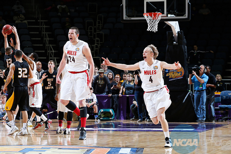 29 MAR 2014: Dillon Deck (24) and Preston Brunz (4) of the University of Central Missouri celebrate at the end of the game against West Liberty University during the Division II Men's Basketball Championship held at the Ford Center in Evansville, IN. Central Missouri defeated West Liberty 84-77 for the national title. Joe Robbins/NCAA Photos