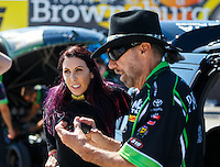 Sep 4, 2016; Clermont, IN, USA; John Paul DeJoria (right) with daughter NHRA funny car driver Alexis DeJoria during qualifying for the US Nationals at Lucas Oil Raceway. Mandatory Credit: Mark J. Rebilas-USA TODAY Sports
