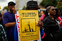A man holds a wanted flyer while people march against police brutality in Staten Island. 08.23.2014. Eduardo Munoz Alvarez/VIEWpress