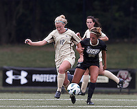 Boston College midfielder Jana Jeffrey (12) works to clear ball as University of Central Florida midfielder Madison Barney (22) defends. After two overtime periods, Boston College tied University of Central Florida, 2-2, at Newton Campus Field, September 9, 2012.
