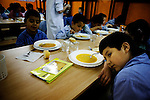 A boy rests his arm next to a soup plate during lunch at Uribarri public school. I visited Uribarri Public School in Bilbao to see how the children of new migrants to Bilbao were settling in with their Spanish classmates. Nowhere is a community&rsquo;s diversity reflected more strongly than in a school.