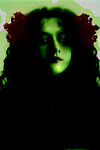 Conceptual image of female face in green