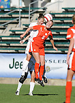 Clemson's Candice Hein (5) and Florida State's Sarah Wagenfuhr (behind) challenge for a header on Wednesday, November 2nd, 2005 at SAS Stadium in Cary, North Carolina. The Florida State University Seminoles defeated the Clemson University Tigers 4-0 during their Atlantic Coast Conference Tournament Quarterfinal game.
