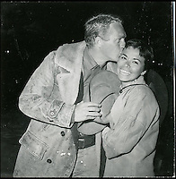 BNPS.co.uk (01202 558833)<br /> Pic: DominicWinter/BNPS<br /> <br /> Steve McQueen pictured with his then wife Noel Adams.<br /> <br /> A remarkable set of 430 candid photographs of Hollywood royalty have been unearthed after 50 years.<br /> <br /> Included in the collection of unpublished pictures are snaps of silver screen icons Paul Newman, Charlie Chaplin, Bette Davis, Audrey Hepburn, and Dean Martin.<br /> <br /> Paul Newman is captured looking over his shoulder at the wheel of his car and Charlie Chaplin is pictured without his trademark moustache. <br /> <br /> Audrey Hepburn has posed with her then husband actor Mel Ferrer while Bette Davis can be seen puffing on a cigarette.<br /> <br /> The snaps were taken by obsessive amateur photographer Dwight 'Dodo' Romero from 1954 to 1967 who would hang around at Hollywood parking lots and other hang-outs to catch a glimpse of the stars.<br /> <br /> The photos, which more recently belonged to a book dealership in York, have emerged for auction and are tipped to sell for &pound;800.