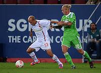 FUSSBALL   1. BUNDESLIGA  SAISON 2012/2013   3. Spieltag FC Augsburg - VfL Wolfsburg           14.09.2012 Tobias Werner (li, FC Augsburg) gegen Simon Kjaer (VfL Wolfsburg)