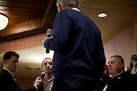 Congressman Ron Paul listens to an audience member's question at a town hall meeting and rally at the Church Landing at Mills Falls hotel in Meredith, New Hampshire, on Jan. 8, 2012. Paul is seeking the 2012 Republican presidential nomination.