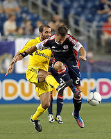 In a battle for the ball, New England Revolution defender Flo Lechner (2) powers through Columbus Crew forward Federico Higuain (33). In a Major League Soccer (MLS) match, the New England Revolution defeated Columbus Crew, 2-0, at Gillette Stadium on September 5, 2012.