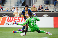 DC United goalkeeper Bill Hamid (28) makes a save on Josue Martinez (17) of the Philadelphia Union during a Major League Soccer (MLS) match at PPL Park in Chester, PA, on June 16, 2012.