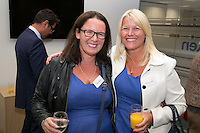 Fashion sense - choosing the same dress in Handelsbanken blue are Katie Aungles of Nook & Cranny and Alison Belfield of Cleggs