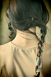 Young woman with long dark hair in braids