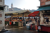Fruit and vegetable stalls in the Rialto Market on the Grand Canal, Venice, Italy. The market was opened here in the 11th century and sells locally caught lagoon and seafood and other fresh produce. The city of Venice is an archipelago of 117 small islands separated by canals and linked by bridges, in the Venetian Lagoon. The historical centre of Venice is listed as a UNESCO World Heritage Site. Picture by Manuel Cohen