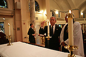 As Reverend Luis Leon looks on, President George W. Bush lights a candle during a service of prayer and remembrance at St. John's Episcopal Church in Washington, D.C., Tuesday, Sept.11, 2007, marking the sixth anniversary of the Sept. 11, 2001 terrorist attacks on U.S. soil. White House photo by Eric Draper.