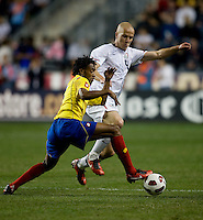 Michael Bradley (4) of the USMNT tries to tackle the ball away from Juan Guillermo Cuadrado (4) of Colombia during an international friendly at PPL Park in Chester, PA.  The U.S. tied Columbia, 0-0.