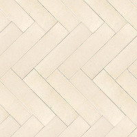 "Herringbone 3"" x 12"" , a hand-cut stone mosaic, shown in honed in Ivory Cream."