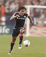 New England Revolution defender Kevin Alston (30) brings the ball forward. In a Major League Soccer (MLS) match, the New England Revolution defeated Chicago Fire, 2-0, at Gillette Stadium on June 2, 2012.