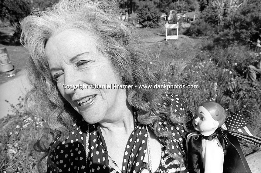A woman with her doll in Berkeley's Peoples Park in 1994.