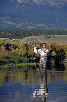 Man fly fishing in the scenic backcountry of the Colorado Rocky Mountains. Oliver Dixon (MR 500). Colorado.