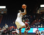 "Ole Miss'  Nikki Byrd (22) shoots as Arkansas' Quistelle Williams (24) at the C.M. ""Tad"" Smith Coliseum in Oxford, Miss. on Thursday, January 12, 2012. Mississippi won 60-54. (AP Photo/Oxford Eagle, Bruce Newman)"