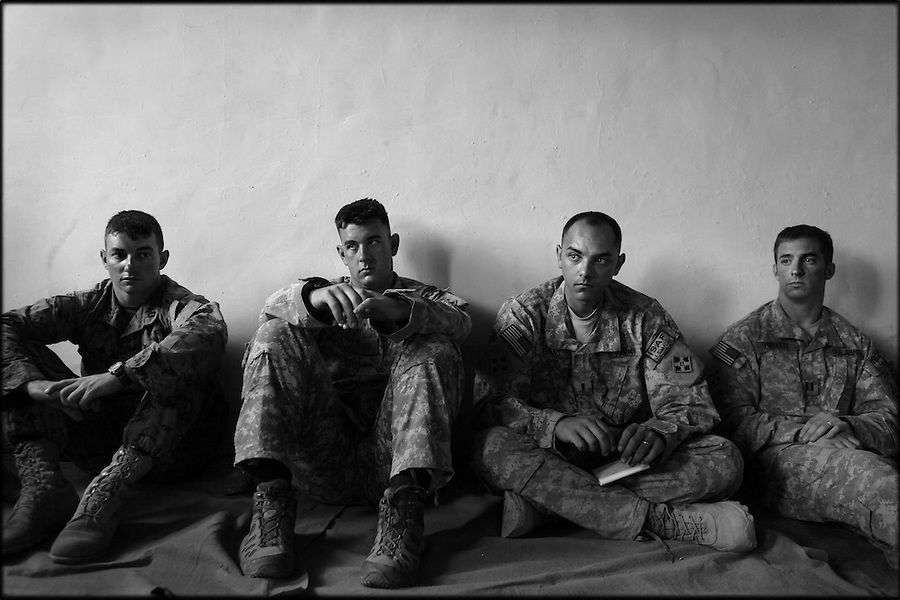 Officers from Baker Co. 2-12 Infantry Regiment 4th Brigade 4th Infantry Division - along with the commander of a US Marine ANA training team (left) - listen to valley residents at a weekly shura in Afghanistan's Korengal Valley in the summer of 2009.